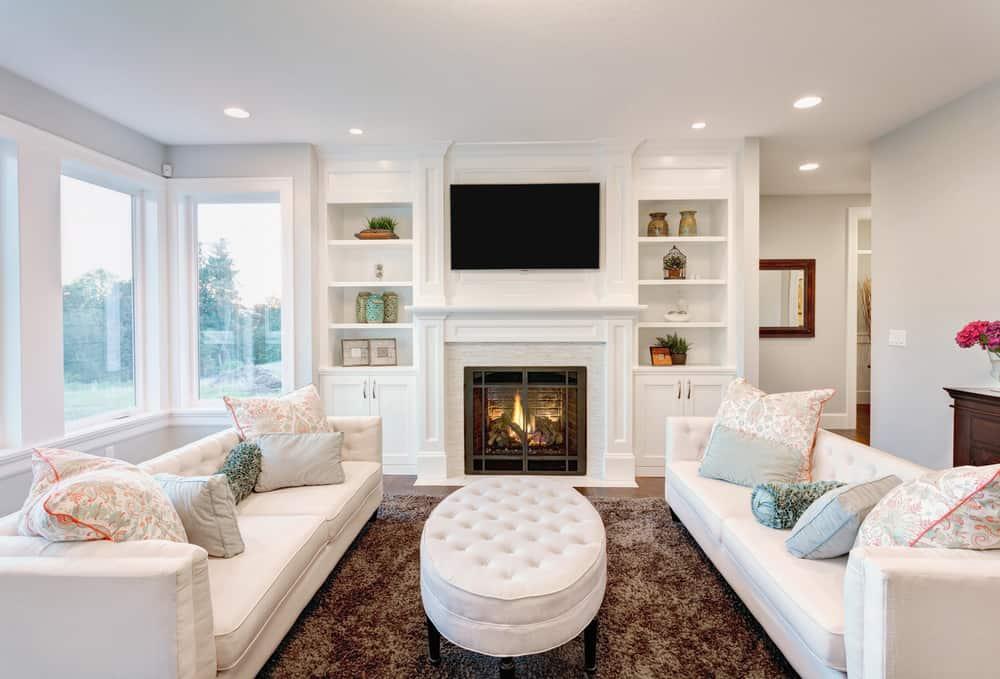 Elegant living room with white sofas