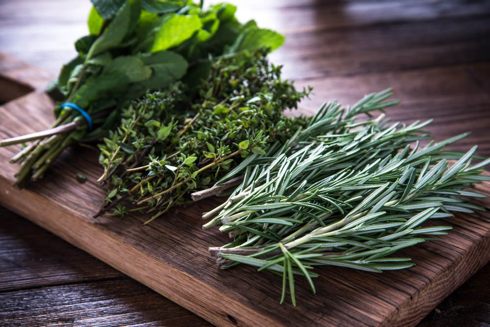 Variety of herbs on a cutting board