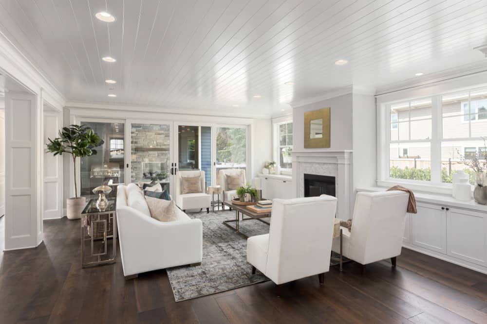 Living room with hardwood floor and white furniture