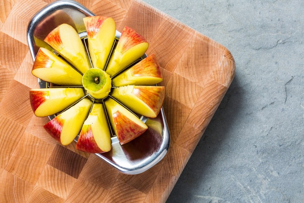 Sliced apple on an apple slicer.