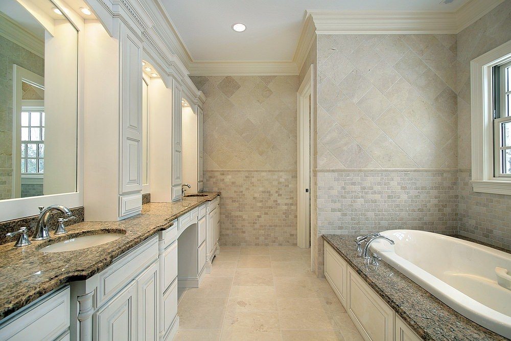 Primary bathroom featuring a walk-in corner shower room, a drop-in deep soaking tub and a long marble sink counter.