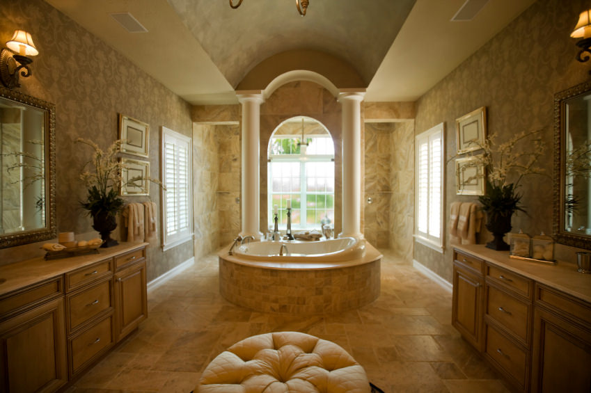Large master bathroom with a gorgeous ceiling and a stunning Romantic-style drop-in tub surrounded by elegantly decorated walls.