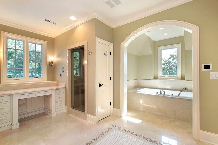 Master bathroom with beige tiles floors. It offers a walk-in shower room and a drop-in bathtub area.