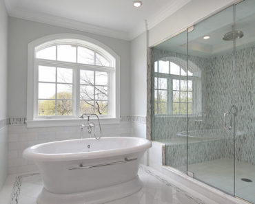 Master bath in new construction home with large glass shower.