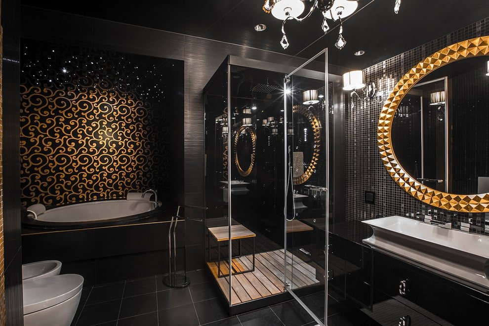 A gold patterned wall sets a classy backdrop to the deep soaking tub situated next to the toilets. It is accompanied by a walk-in shower and a high gloss vessel sink vanity accented with a gorgeous round mirror.