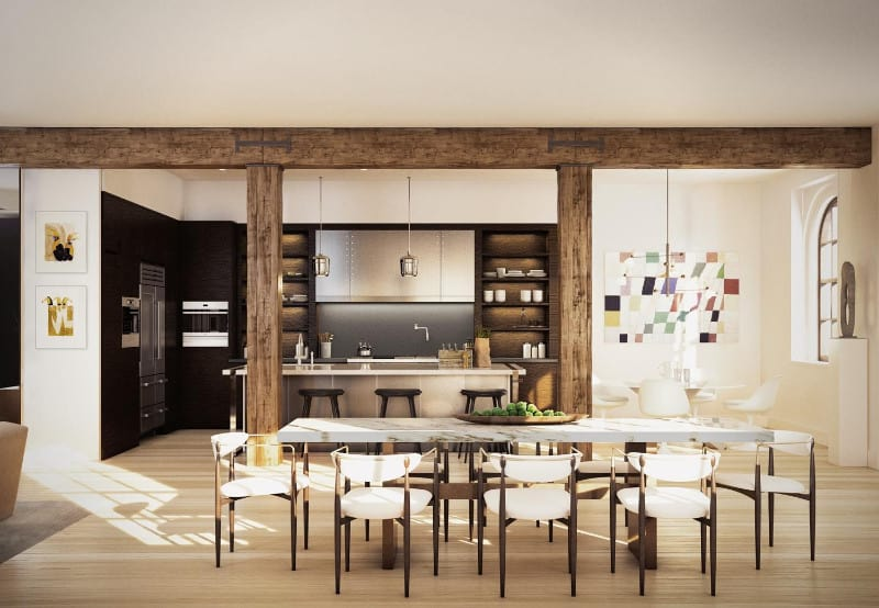 An open kitchen framed with large, rustic beams features open shelving and inset appliances against the dark wood cabinets. It includes a stainless steel island and white dining set on the side accented by a multicolored artwork.