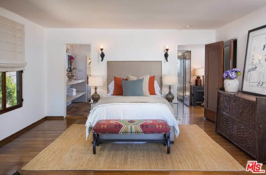 A focused look at this master bedroom's bed set. The room offers a personal walk-in closet and bathroom as well.