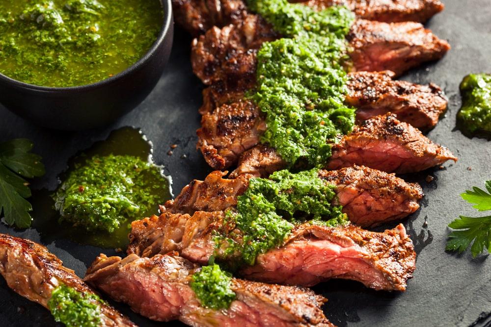 Chimichurri spread on steak cuts