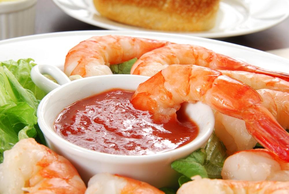 Cocktail sauce on a serving of shrimps.