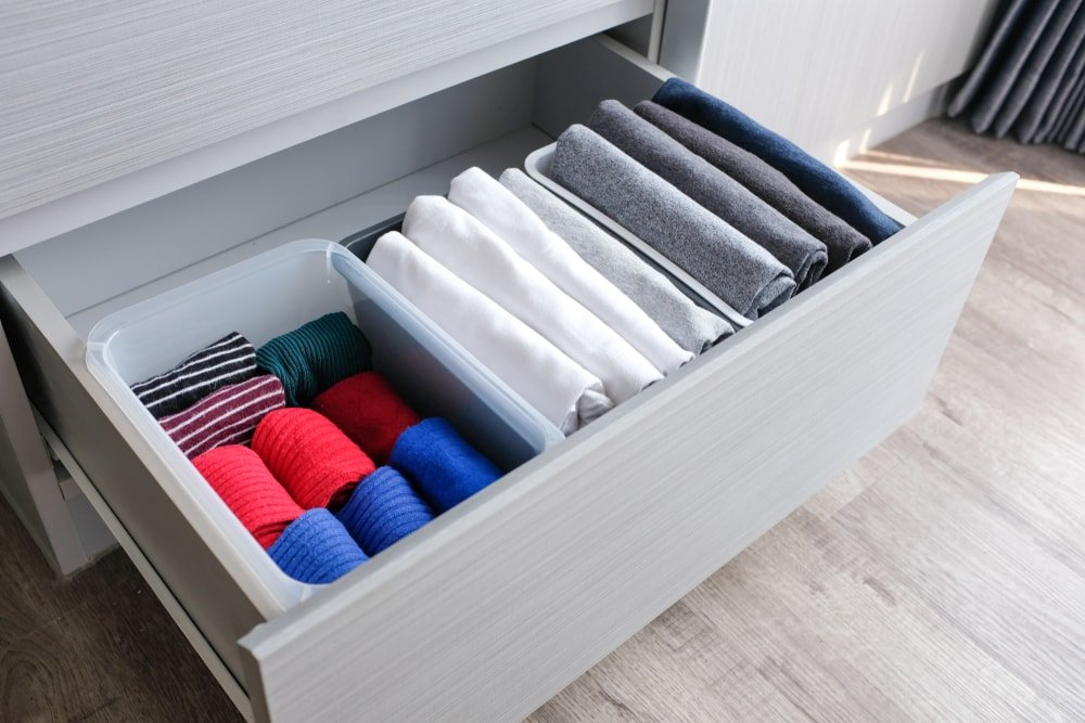 Drawer with folded socks and shirts.