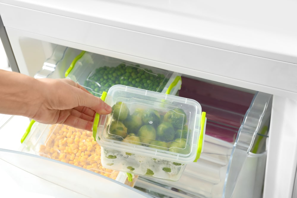 Placing food storage in the fridge.
