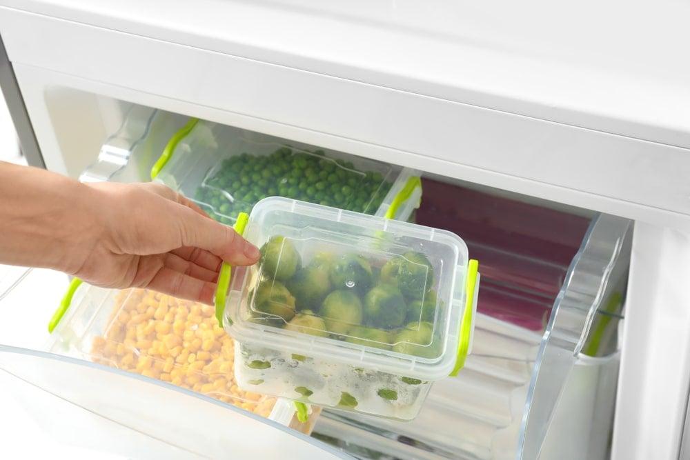 Placing food storage in the fridge.