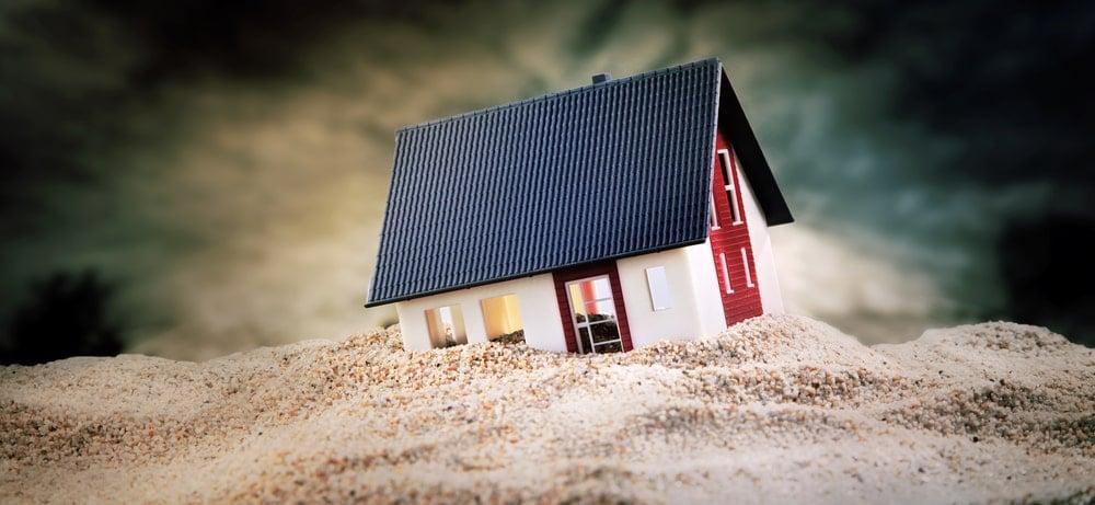Miniature house on soil.