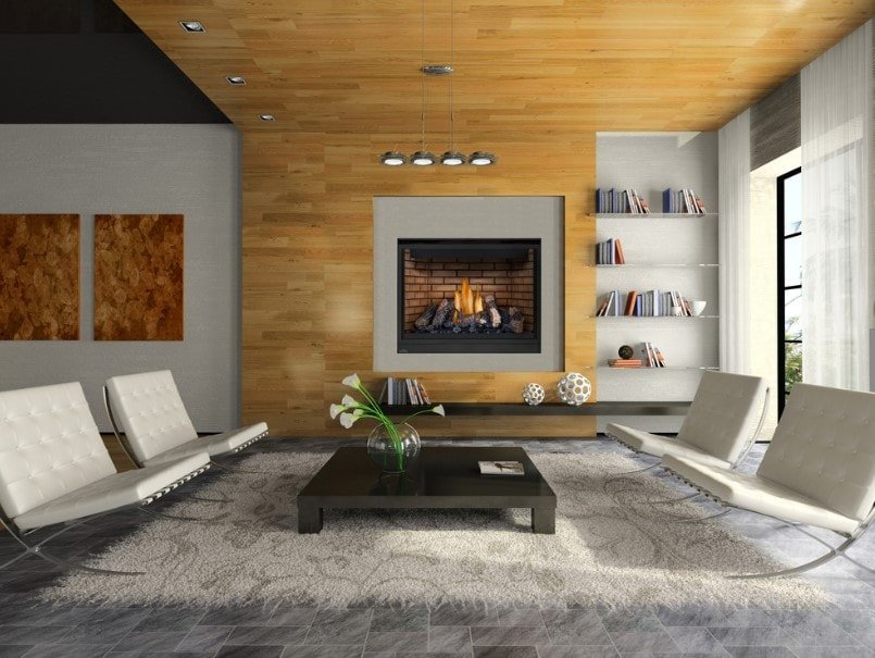 A modern living room boasting stylish set of seats and center table, along with a large fireplace on the wall.
