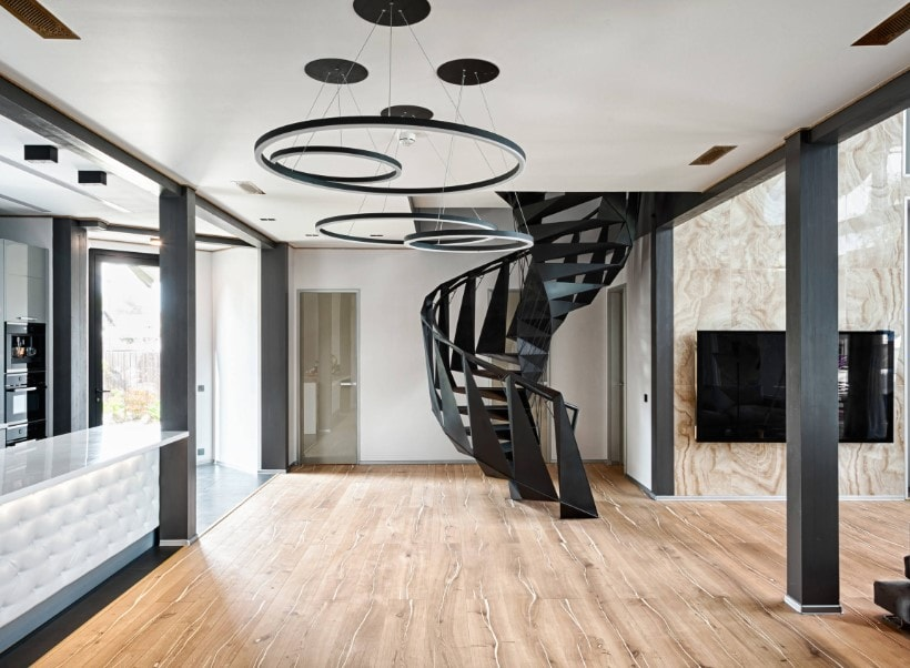 A contemporary house boasting a stylish ceiling and a stunning elegant black spiral staircase.