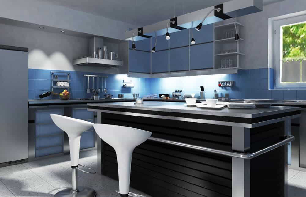 Modern L-shaped kitchen with blue tiles backsplash. It offers a center island with stainless steel countertop, and has a breakfast bar with white modern seats.