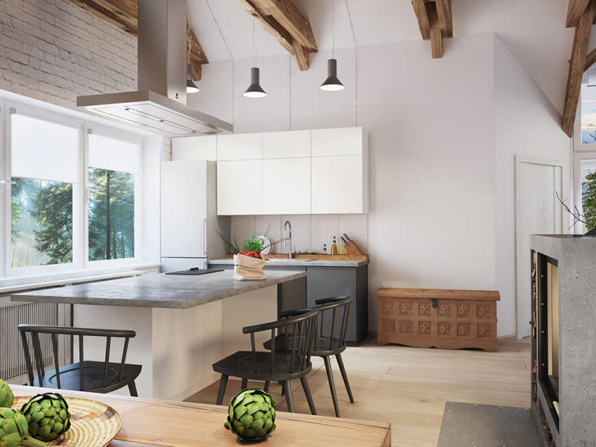 This kitchen boasts a large island with a stylish gray countertop, along with a small kitchen counter with a similar countertop.