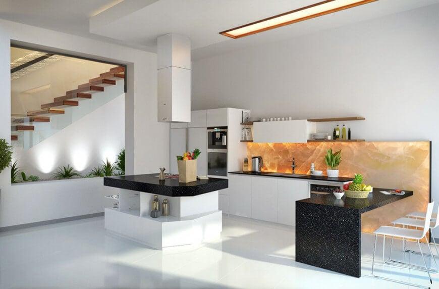 A modern kitchen boasting black countertops on the kitchen counter, the center island and the breakfast bar counter.