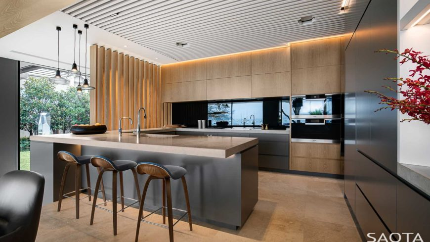 Modern kitchen with stylish black kitchen counters and a breakfast bar counter with thick countertops.