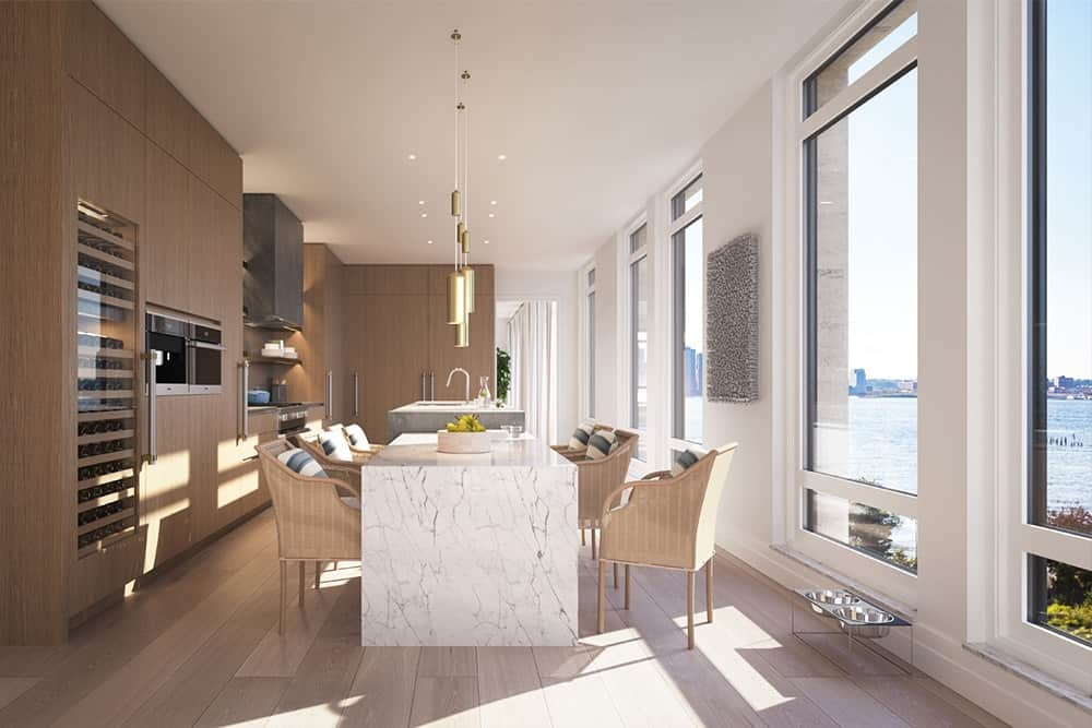 Large modern kitchen offering a marble waterfall-style breakfast bar island with comfy rattan seats and lighted by elegant pendant lights.