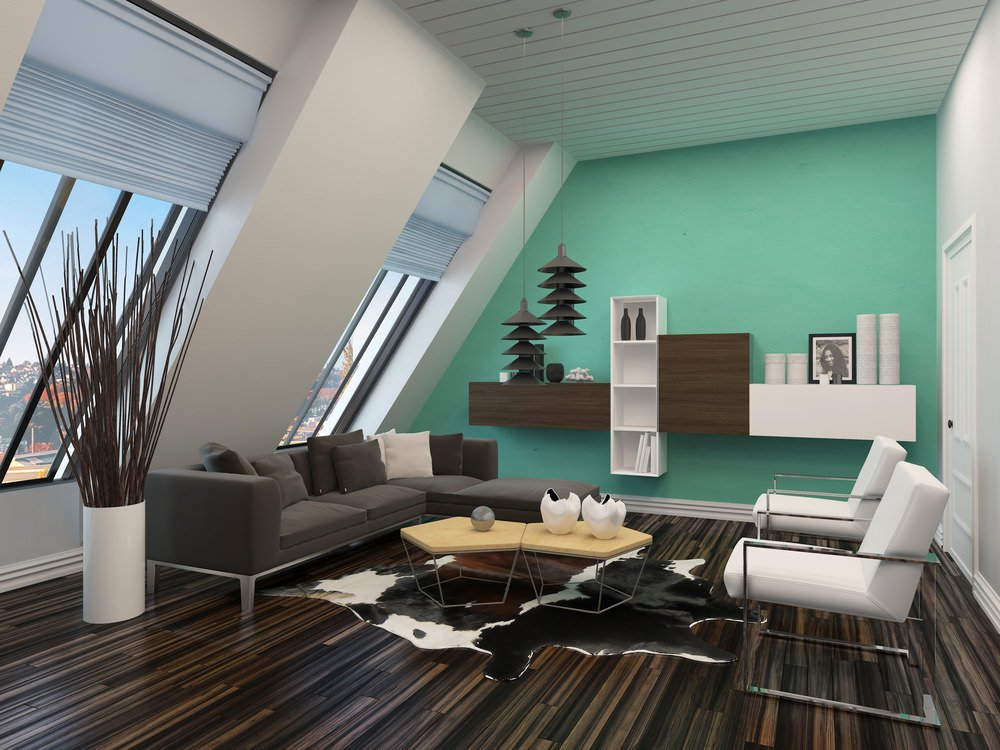 Contemporary-style living room boasting stylish flooring and a green wall. The room offers a modern gray L-shaped sofa along with built-in shelves and stylish pendant lights.