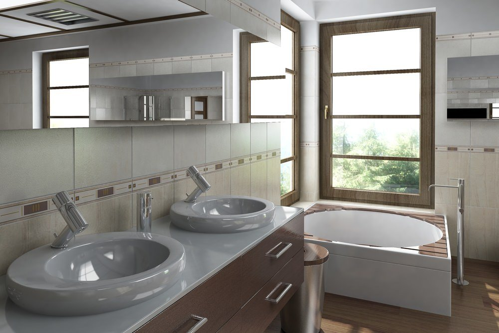 The contemporary master bathroom offers a corner tub by the wooden framed windows along with a wooden vanity fitted with modern vessel sinks and faucets.