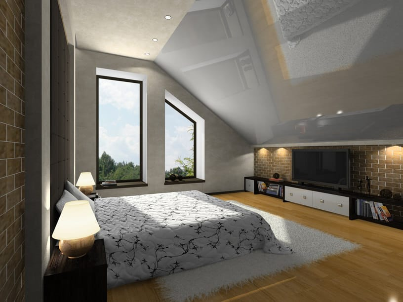 Primary bedroom featuring a custom ceiling and gray walls. The room has a stylish and comfy bed set along with glass windows.
