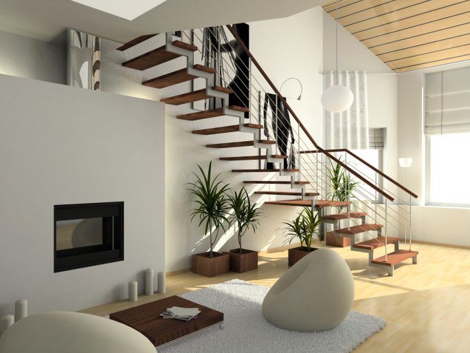 A contemporary home boasting a modern living space and a stylish quarter-turn staircase with hardwood steps, lighted by white pendant lights.