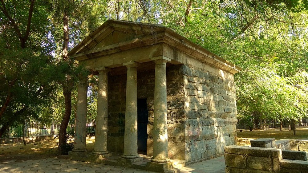 Artificial ruins of the Tuscan order small stone temple.