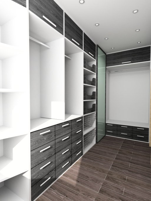 A dark hardwood flooring adds warmth in this sleek walk-in closet with white shelving and gray pull-out drawers illuminated by recessed ceiling lights.