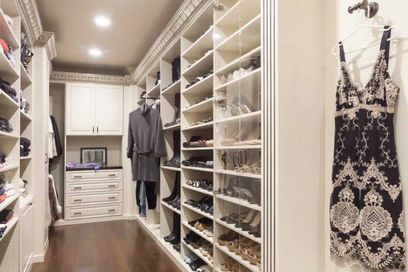 This may be a small walk-in closet but it is loaded with full height storage. White cabinets run throughout maintaining a cohesive design.