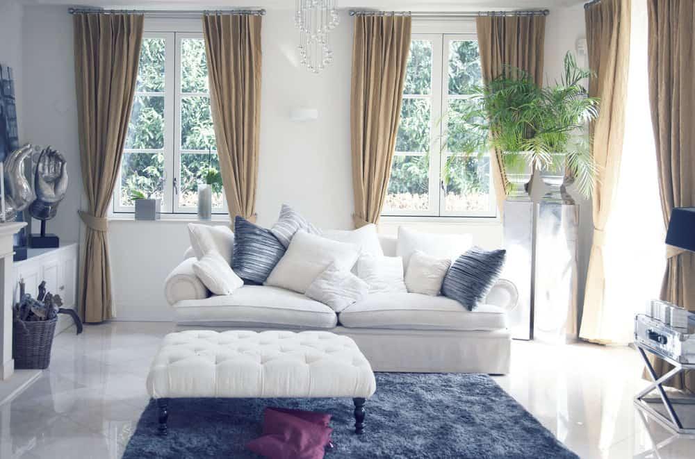 White sofa with blue living room decor