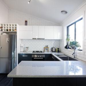 Example of a kitchen with subway tile backsplash
