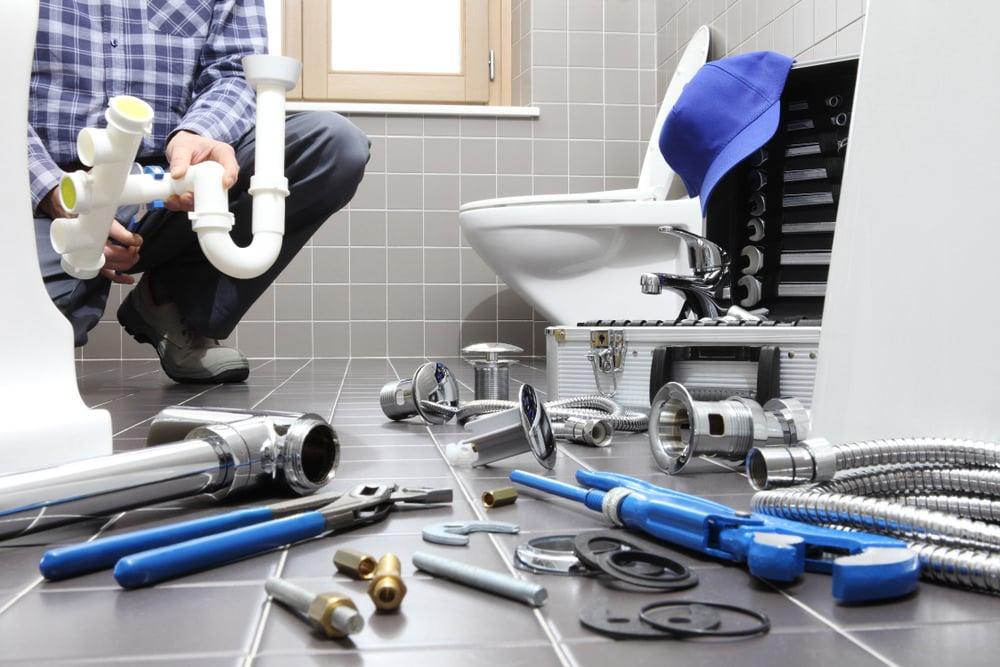 Plumber installing a toilet