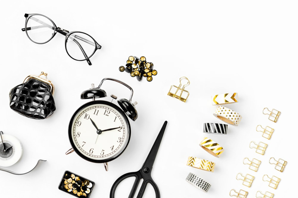 Washi Tapes, Alarm Clock, Scissors, Eyeglass, and Other Trinkets on a White Background.