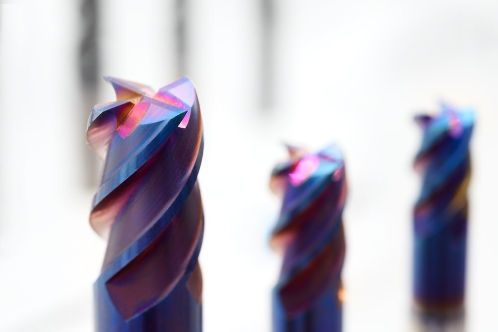 Drill bits with bronze violet coating.