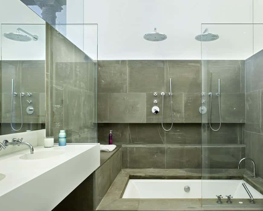 Small primary bathroom with a white floating vanity with a double sink and a walk-in shower and bathtub combo.