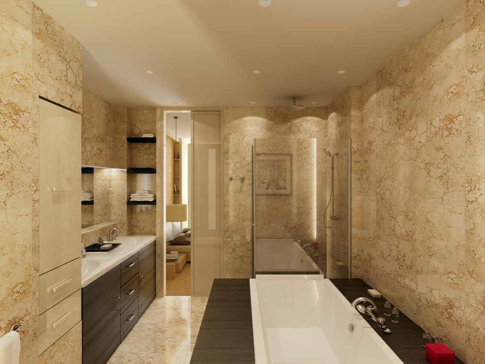 Primary bathroom with brown elegant walls along with a ceiling featuring recessed ceiling lights. The room has a sink counter with two sinks and a glass walk-in shower, along with a drop-in soaking tub on the side.
