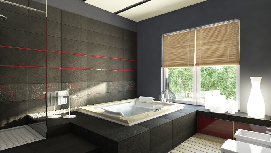 Primary bathroom with a custom black wall surrounded by gray walls of the room. There's a drop-in deep soaking tub and a walk-in shower room as well.