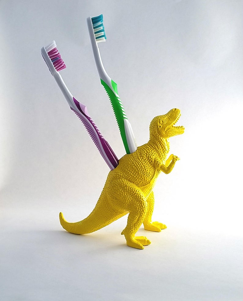 Dinosaur toothbrush holders