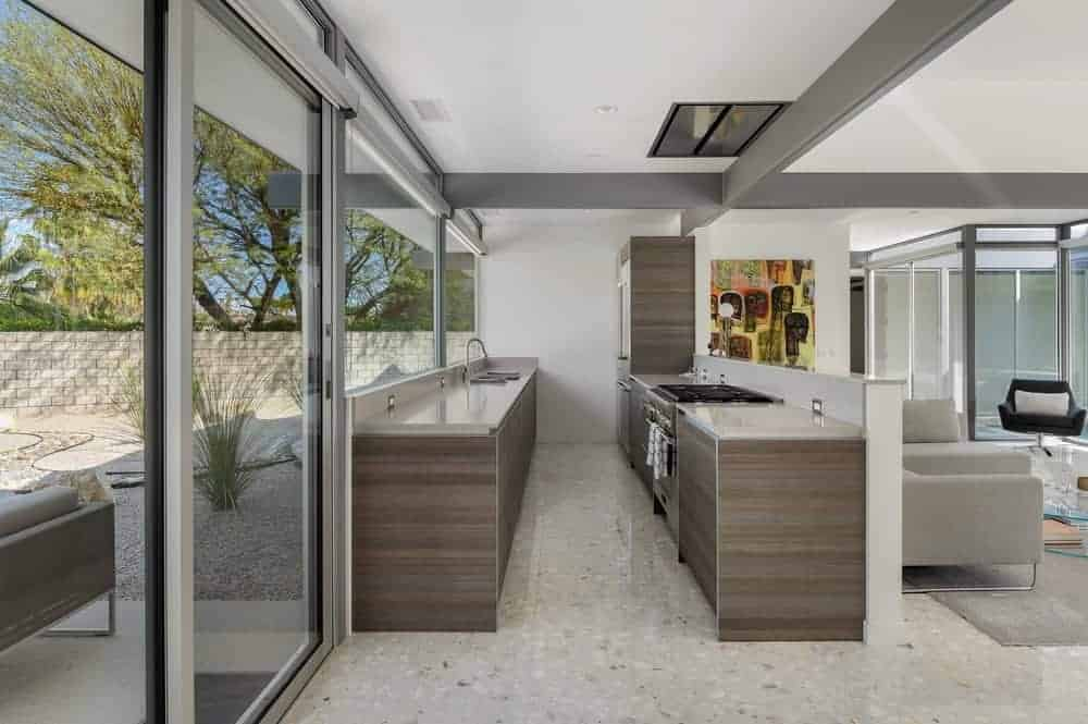 A narrow kitchen with modern kitchen counters that look absolutely stylish.