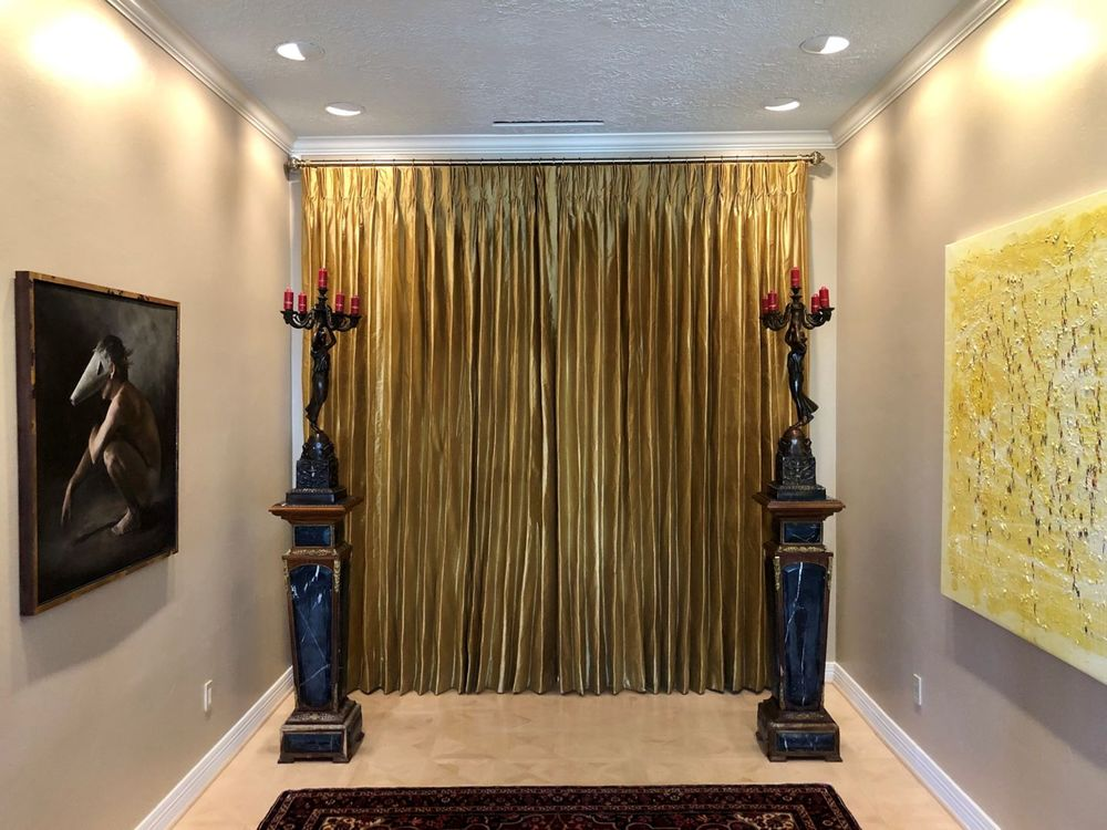 Golden Drapery In A Lively Bedroom Featuring Contemporary Art Pieces