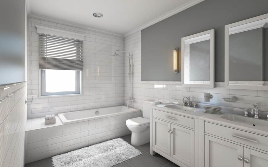 Elegant white master bathroom featuring a soaking tub and shower combo and a sink counter featuring a double sink.