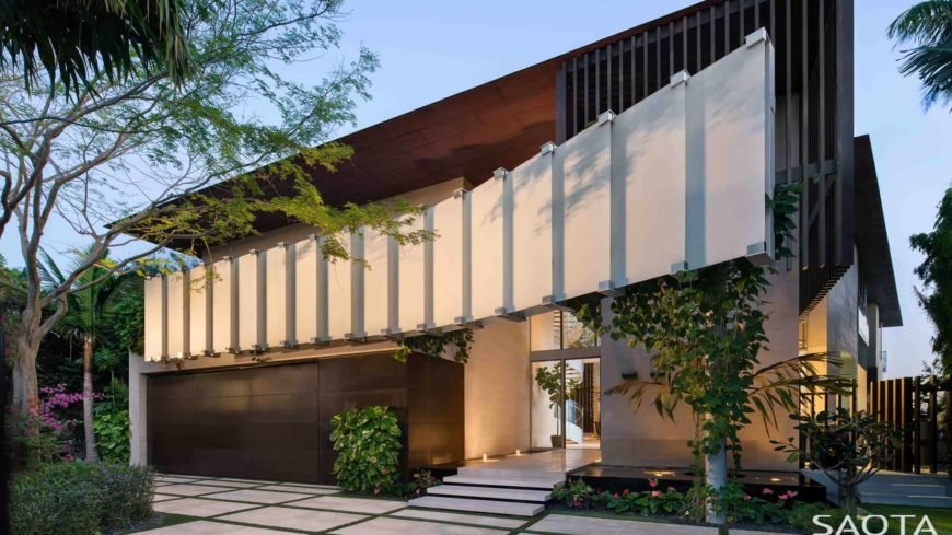 A contemporary custom made home with a striking exterior design. The house offers a relaxing and fantastic outdoor amenities, as well as multiple healthy plants and trees.