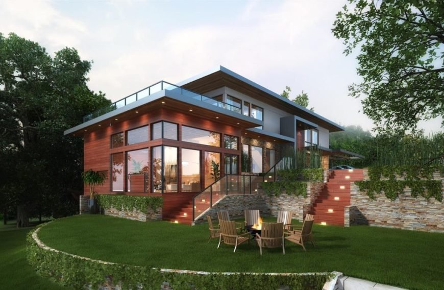 A modern house with a stunning exterior with glass windows and doors, along with a large balcony area. It offers fine walkways, along with beautiful garden and lawn areas.