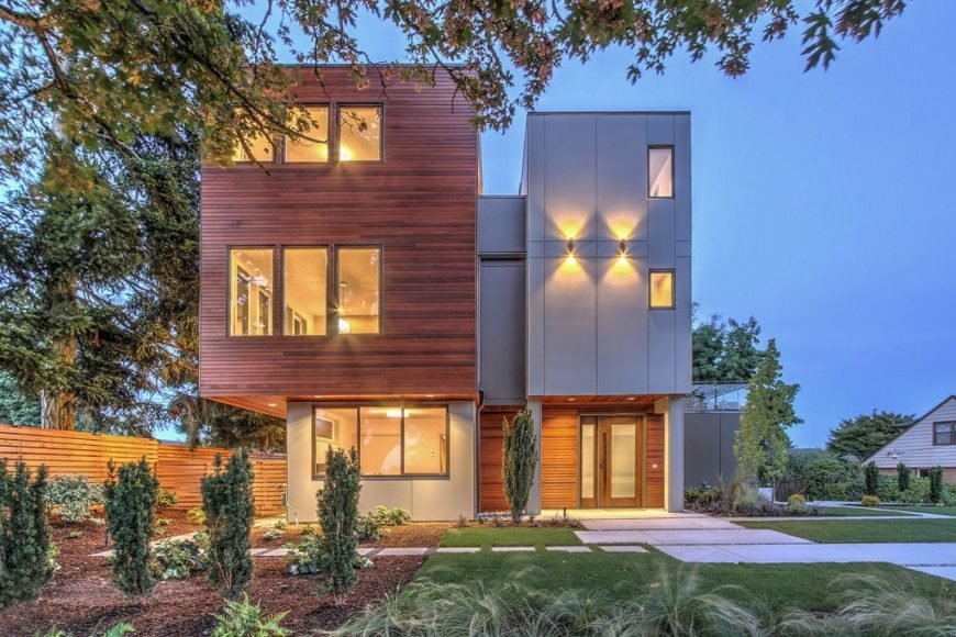 This house boasts a striking exterior design and has a warm interior lighting. The house offers a peaceful backyard with well-maintained lawns and a beautiful garden area.