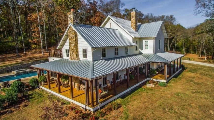 A nice house with a great exterior design. It offers a deck and a patio, an outdoor dining table set and an outdoor swimming pool, along with a beautiful lawn area.