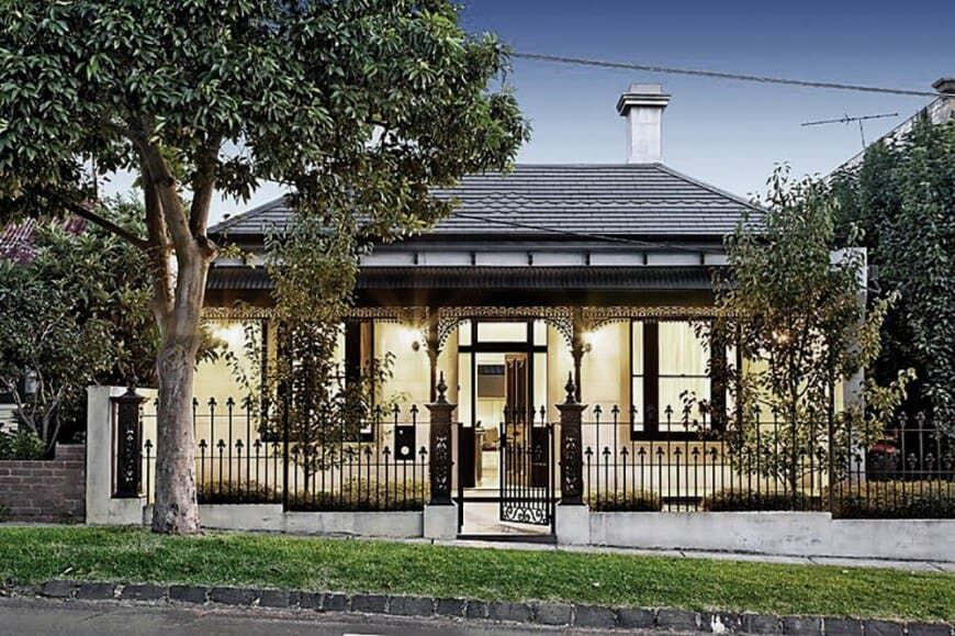 This house has a pleasant exterior design. The home has a nice front yard garden protected by a gorgeous iron fence and gate.
