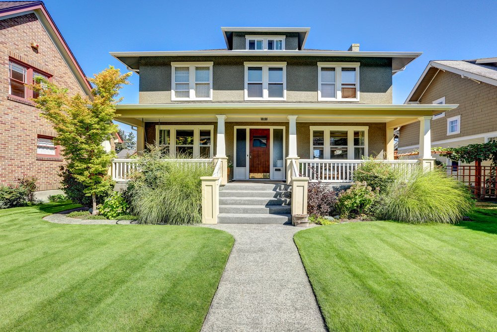 This house has a fine exterior along with a walkway surrounded by gorgeous lawns and garden areas.