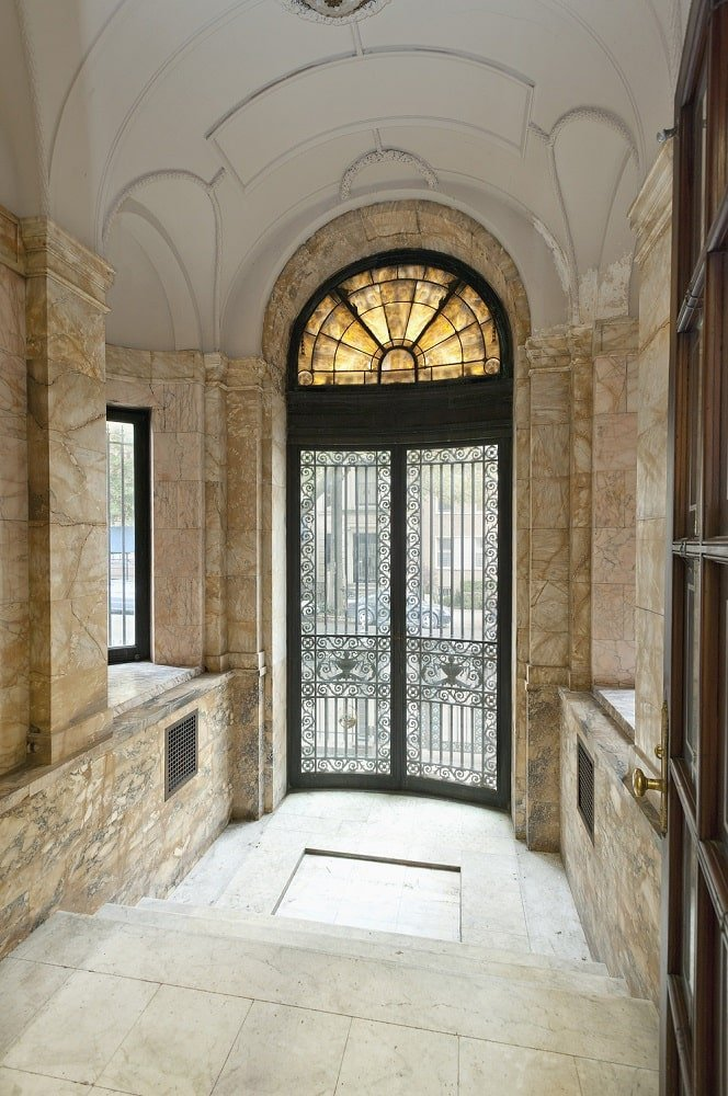 Upon entry of the house, you are welcomed by this small foyer with beige walls that make the black wrought-iron main door stand out. This brings in an abundance of natural lighting for the foyer.